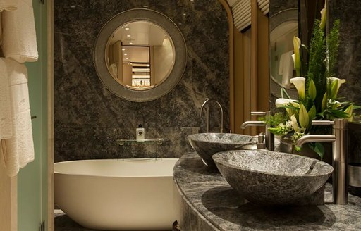 Close up of sinks and large bath on superyacht Sea Rhapsody