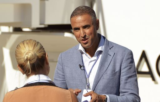 Man speaking to woman at Monaco Yacht Show 2018