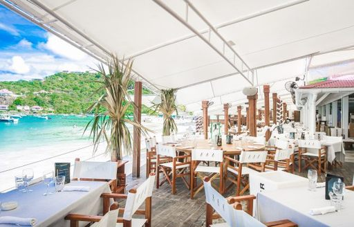 Tables and chair arranged the restaurant at Nikki Beach St Barts