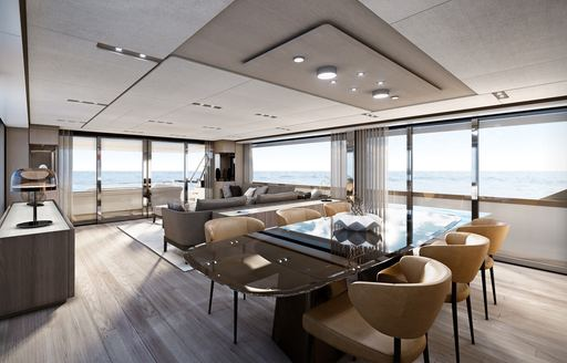 Elegant dining table and chairs in salon on Ferretti superyacht EPIC