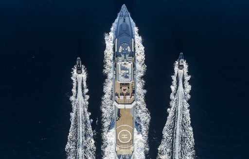 BOLD yacht aerial shot with two tenders
