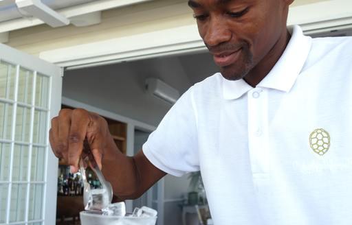waiter serves ice on thanda island