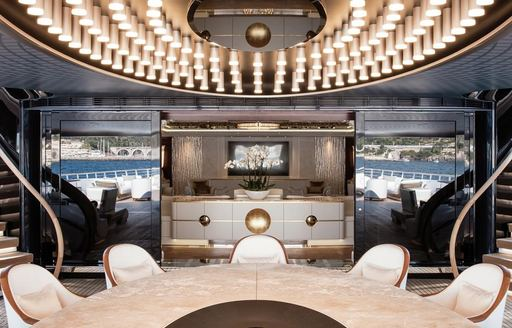 alfresco dining with glimpse of luxe interior on board luxury yacht JUBILEE