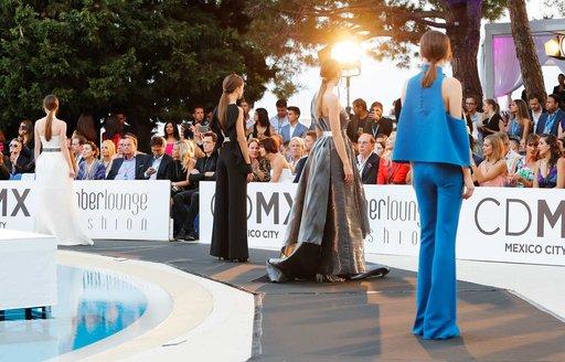 models on catwalk at amber lounge fashion show during monaco grand prix