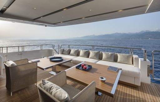 tables, chairs and sofas on the aft deck of superyacht DINAIA