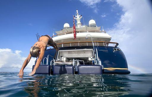 female charter guest dives off swim platform of luxury yacht JO