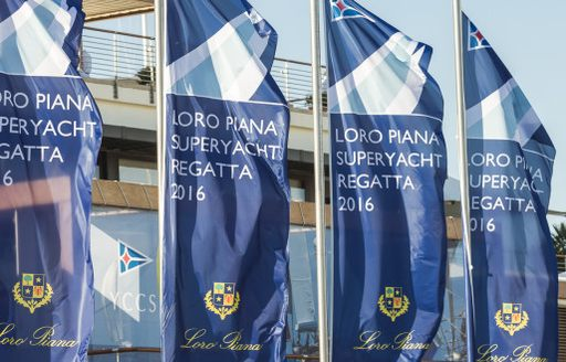 flags wave in the breeze at the LORO PIANA SUPERYACHT REGATTA