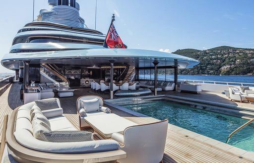 swimming pool surrounded by seating on board motor yacht JUBILEE