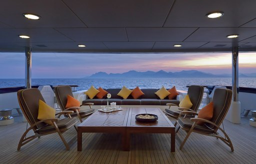 large lounging area on the main deck aft of charter yacht Deja Too