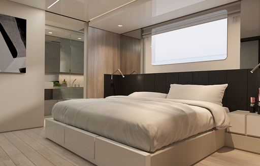 Double bed in lightly colored cabin on Explorer yacht EMOCEAN