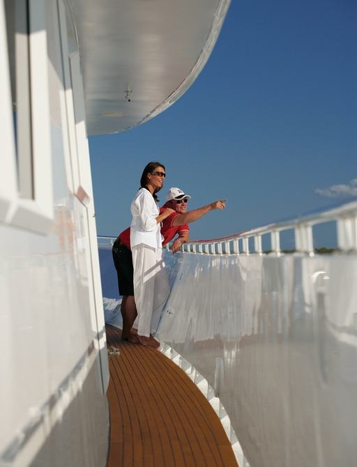 charter guests look across the water on board luxury yacht 'Emerald Lady'
