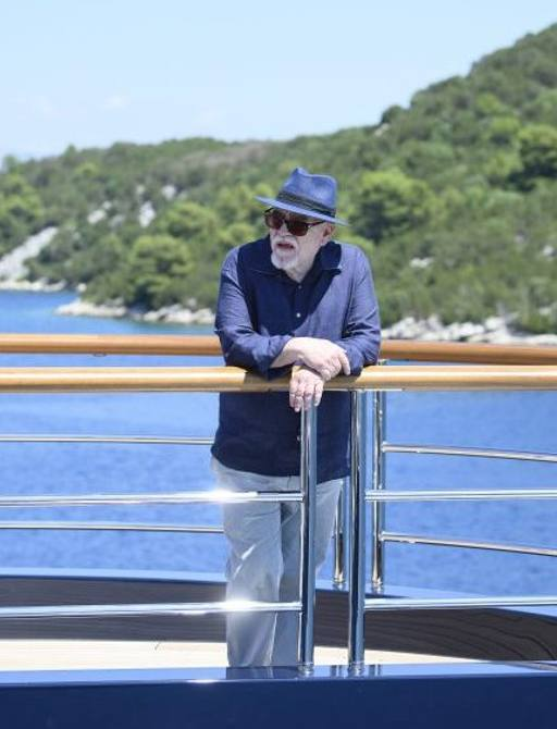 Logan Roy stands on SOLANDGE superyacht from SUCCESSION TV series