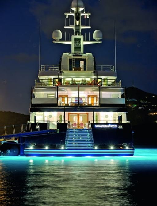 stern view of superyacht 'Northern Star'  lit up at night