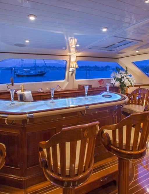 Pilot house bar at dusk on board superyacht Whisper