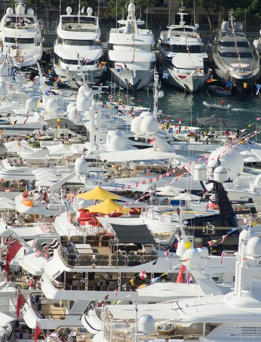 superyachts lined up in Monaco Harbor to watch the Monaco Grand Prix