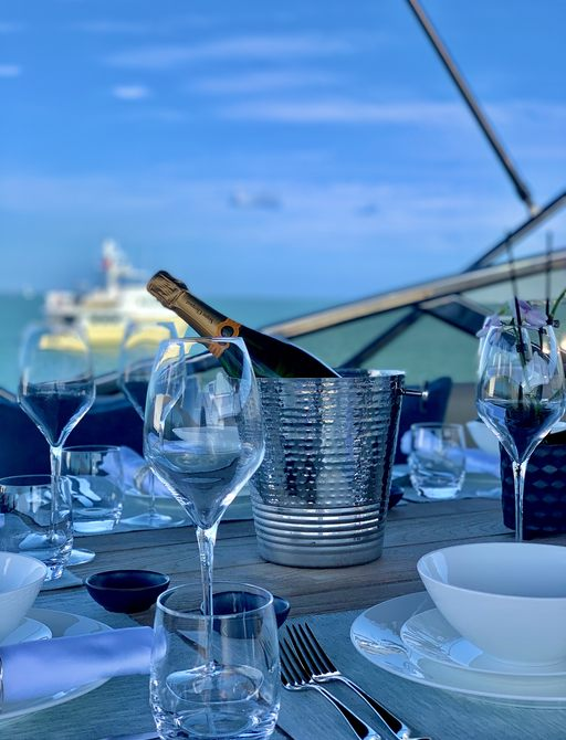 champagne on table on board luxury yacht chess