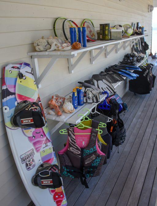 toys lined up outside boathouse on thanda island