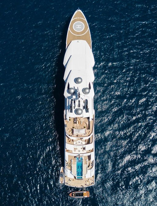 Aerial shot of superyacht AMADEA surrounded by blue Mediterranean water