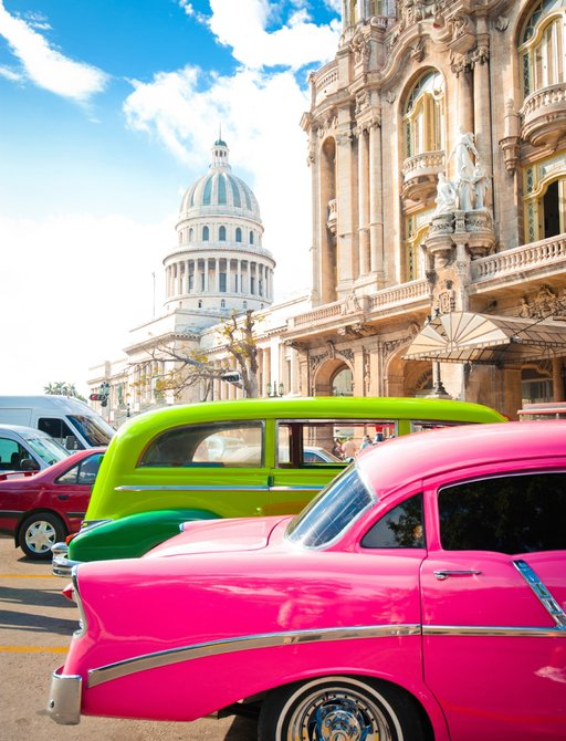 colourful vintage cars park in cuban streets lined with colonial architecture