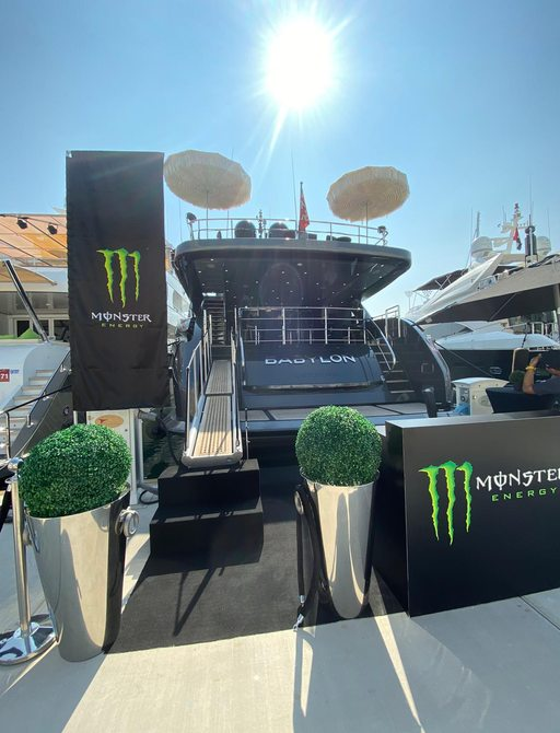 Sun blaring over superyacht Babylon as it is berthed by Yas Marina docks on the first day of Abu Dhabi grand Prix 2019 with monster energy drink sponsorship