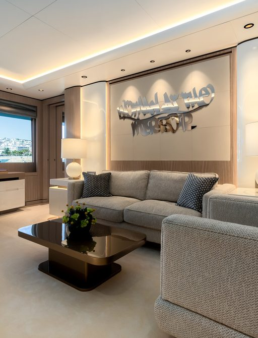 Comfortable seating area, with two sofas and small table and artwork on wall behind on superyacht O'PARI