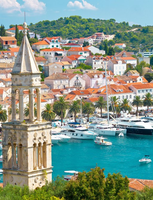 Harbour in Croatian town, with yachts lined up along the water