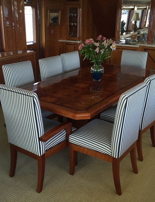 dining table in main salon of charter yacht SANCTUARY
