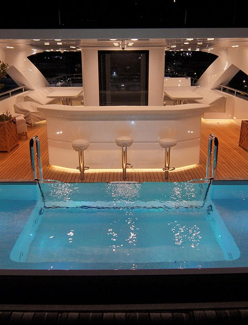 pool on sundeck of baba's yacht with bar and sunpads