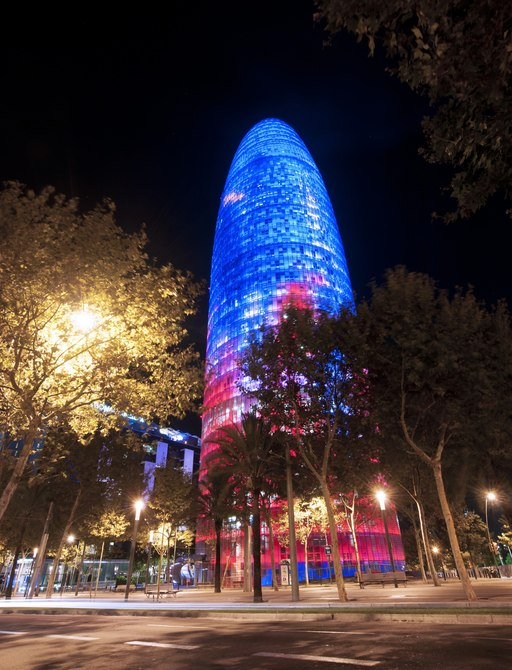 Torre de Control Building lit up at night in Barcelona