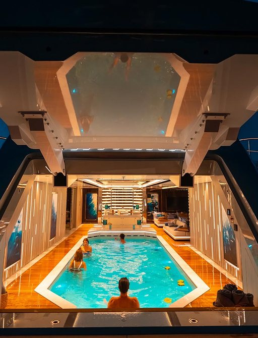 pool in beach club on superyacht tatiana