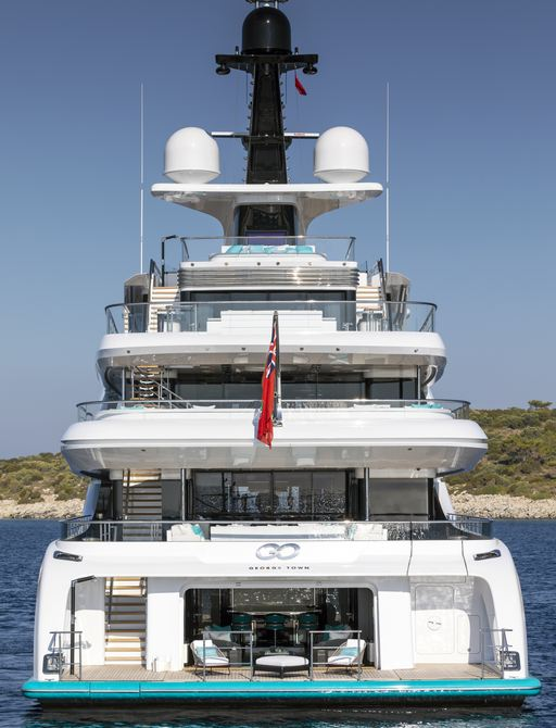 aft view of motor yacht GO with beach club in view