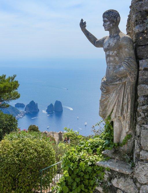 statue overlooking the sea of capri