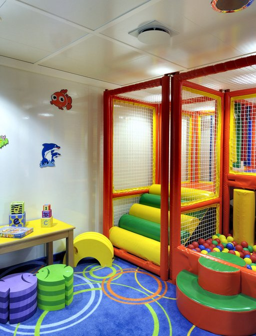 Soft play room with ball pit and wall stickers on board superyacht Lauren L