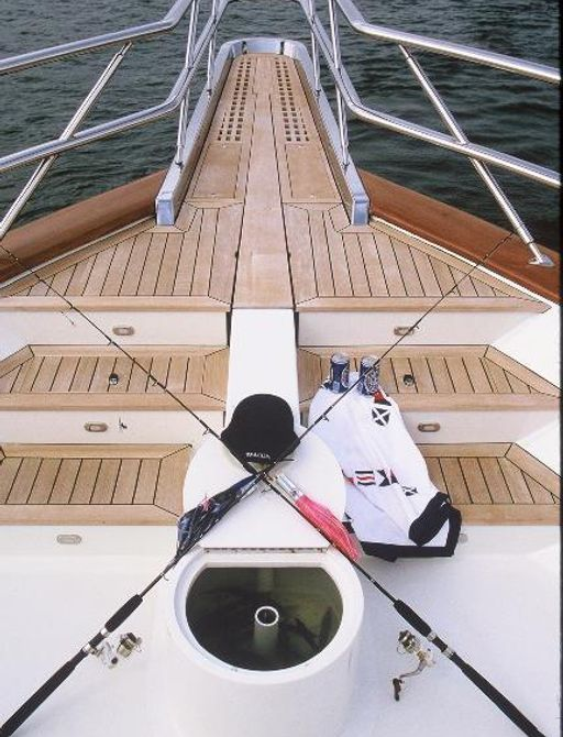 fishing rods on the deck of a luxury yacht
