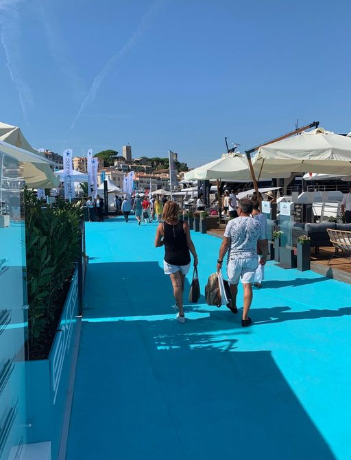 People enjoying the sunshine at cannes yachting festival 2019