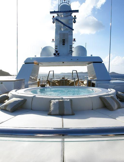 Jacuzzi and sunpads on sundeck of superyacht HARLE