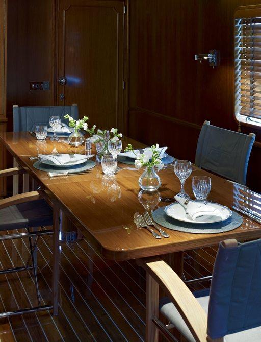 formal dining area in main salon of luxury yacht 'Heavenly Daze'