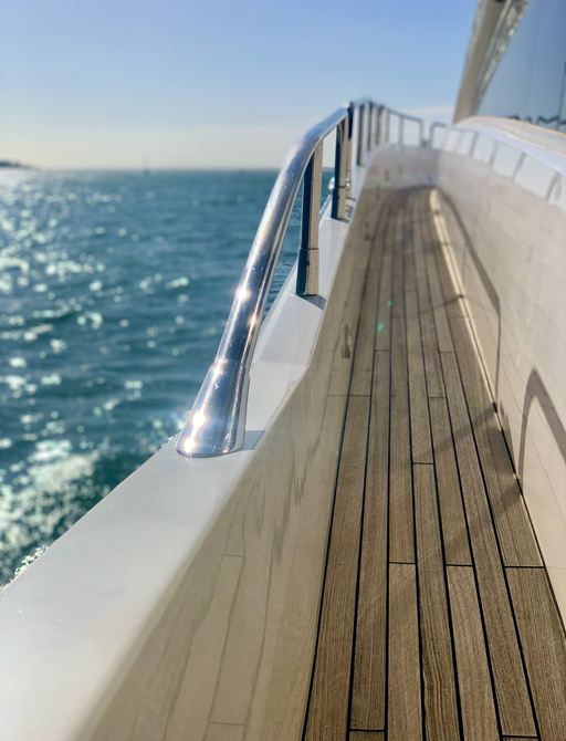 teak decking and steel handrails of superyacht chess