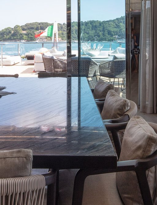 Dining table and aft deck of superyacht MA
