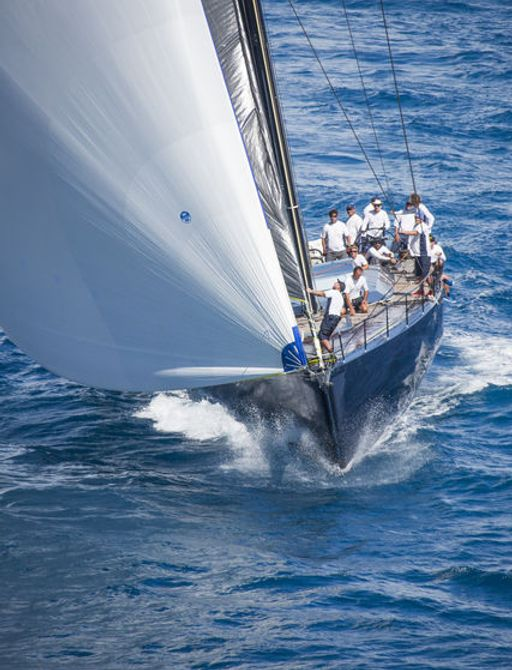 sailing yacht cuts through the Caribbean waters as part of the RORC Caribbean 600