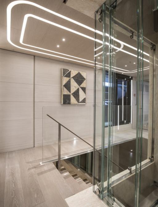 glass elevator and staircase on board superyacht