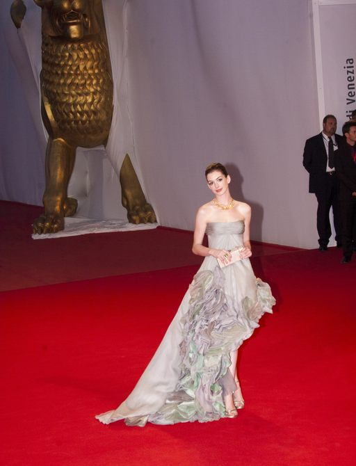 Anne Hathway wears a grey gown on the red carpet at the Venice Film Festival