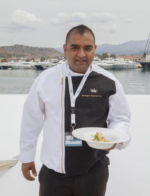 The chef onboard motor yacht AURORA photographed with his competition dish