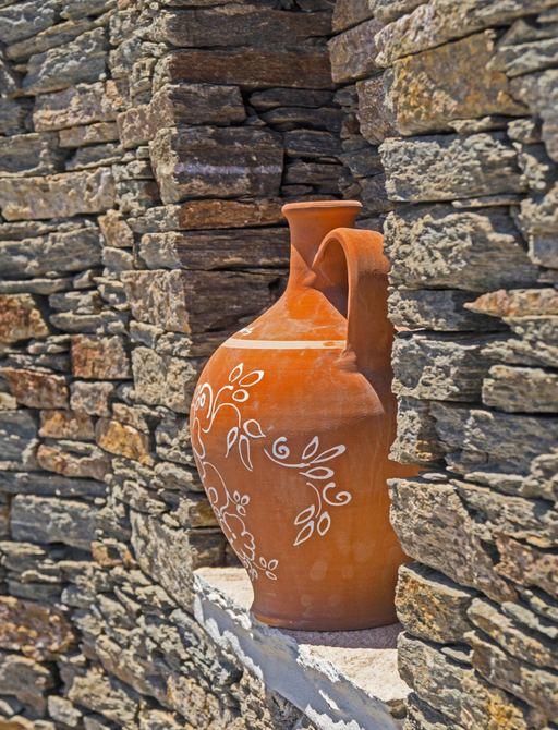 Terracotta pottery in window in Sifnos, Greece