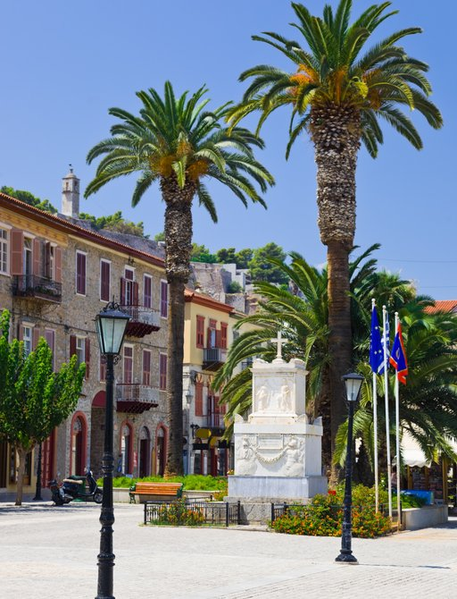 town centre of Nafplio, Greece, lined with palm trees