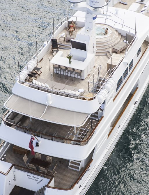 bar, seating and spa pool on the sundeck of luxury yacht RELENTLESS