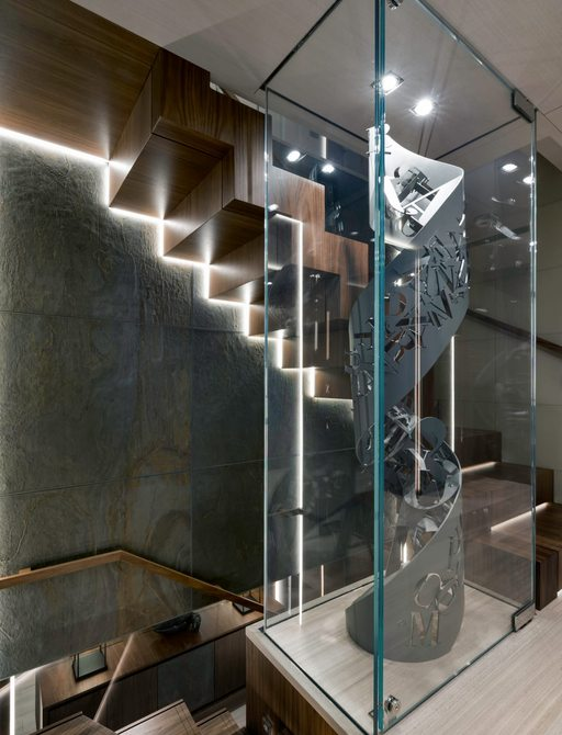 staircase on luxury yacht utopia iv with sculpture commissioned for loren ridinger
