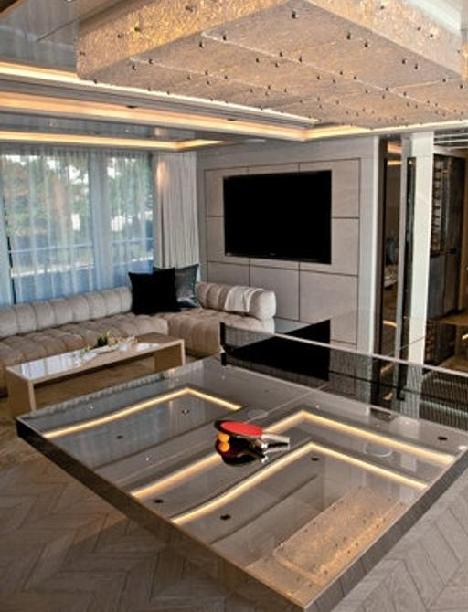 Table tennis table and TV in games room of superyacht Odessa II