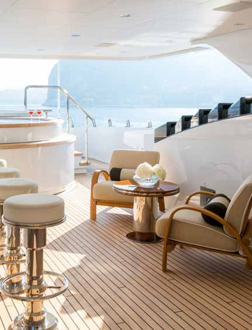Sundeck on luxury yacht W, with bar and lounge area