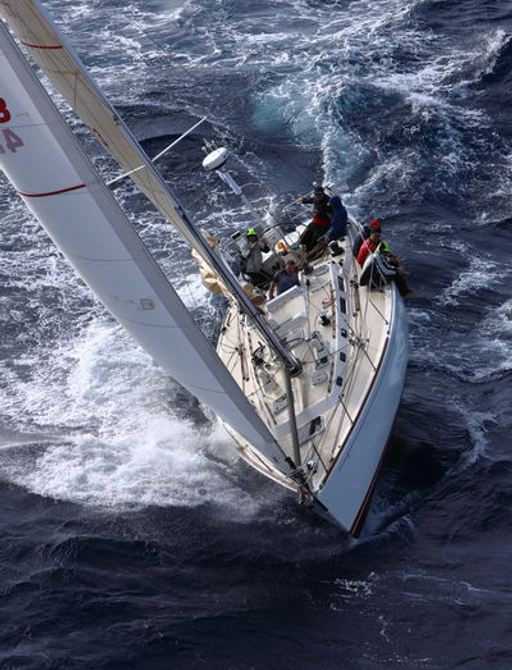sailing yacht cuts through the water while participating in the RORC Caribbean 600